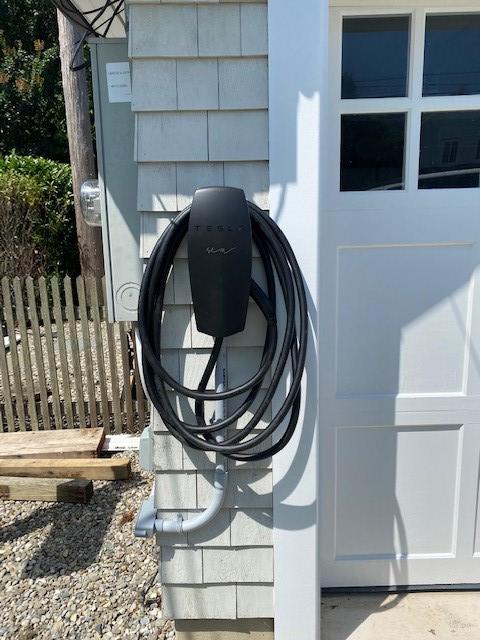 Black Tesla charging station